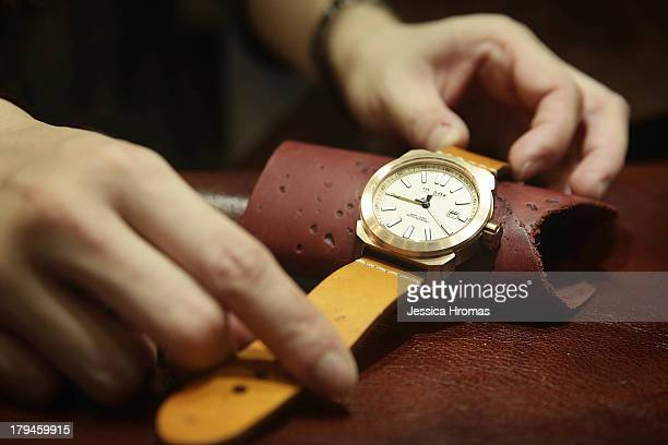 The strap of a mens bronze Switszer watch valued at USD $850 is sdjusted on the Global Line Limited Stand at the Hong Kong Watch And Clock Fair on...