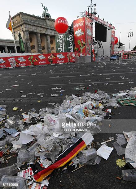 The street in front of the Brandenburg Gate is covered with garbage early June 26 2008 after supporters crowded the 'Fanmeile' for a public viewing...