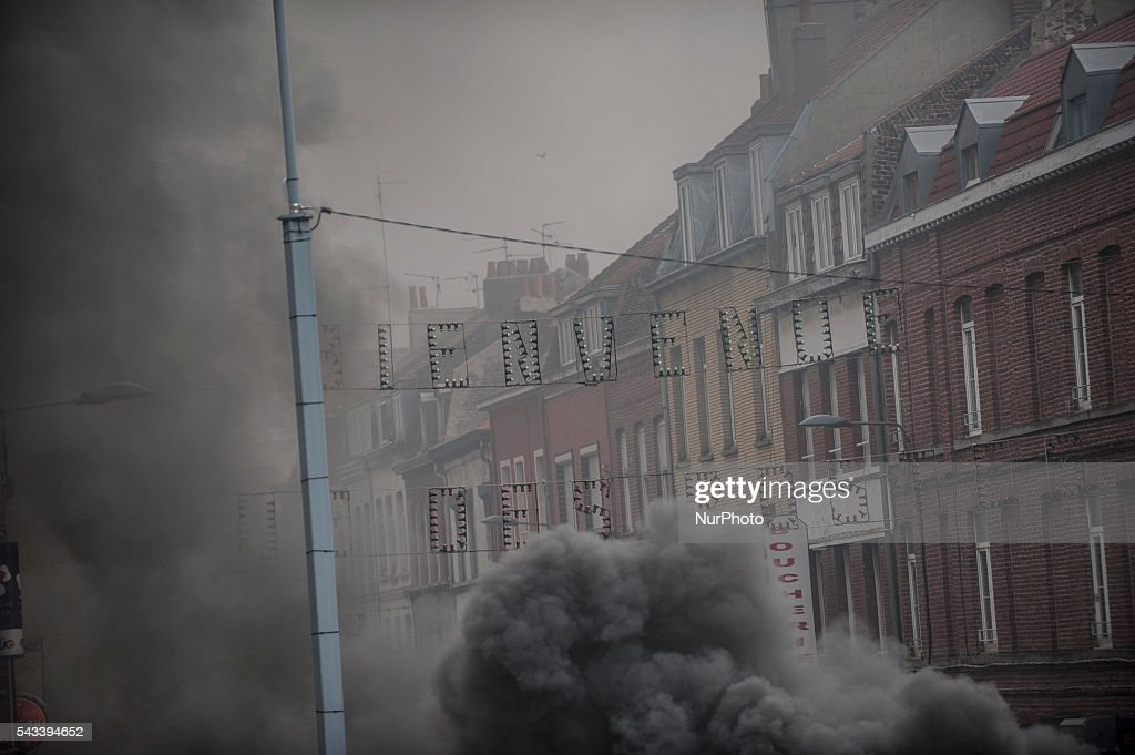 The street of Posts is invaded by smoke from burning tires barricades in Lille, France on june 28, 2016. A new national day of action against labor law takes place throughout France. Economic blocking action was planned by the CGT in Lille this morning at 6:30 am.