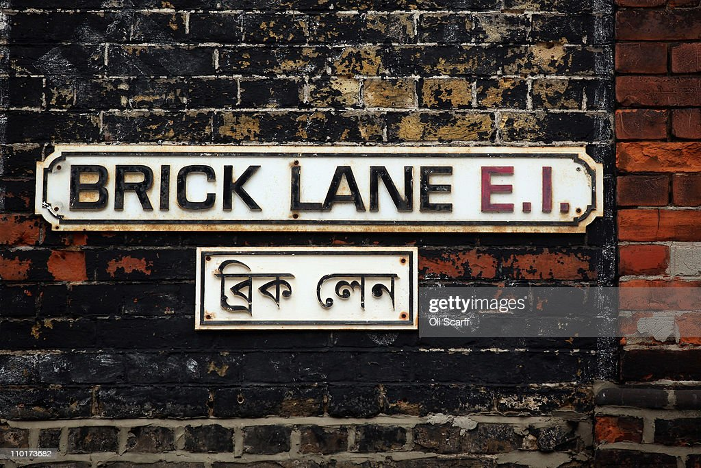 The street sign for Brick Lane which is synonymous with curry restaurants March 16, 2011 in London, England. From April 2011 the Government has ruled that only graduate-level workers will be allowed to migrate to the UK from outside the European Economic Area with the total number of skilled migrants capped at 21,700. Concerns have been raised on the effect of this legislation on curry restaurants as chefs will need a minimum of five years' experience, and must earn at least 28,260 GBP a year after accommodation and food.
