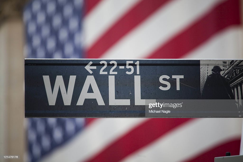 The street sign for Wall Street is displayed in front of the New York Stock Exchange on August 19, 2011 in New York City. The Dow ends another volatile week, closing more than 100 points Down for the day.