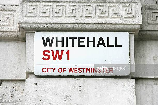 The street sign for Whitehall sits on a building across from Britain's Houses of Parliament on September 17 2004 in London England