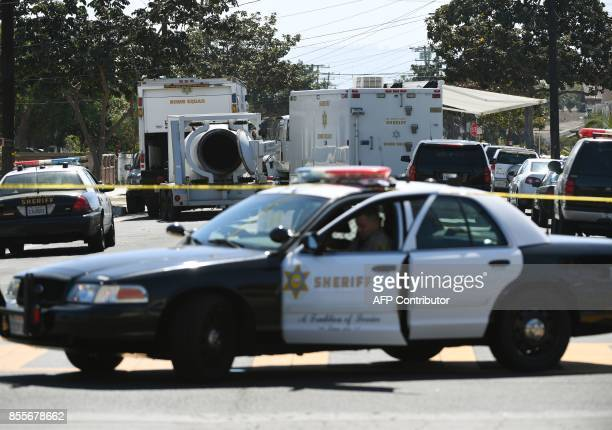 The street where a Los Angeles County Sheriff's Department bomb and hazmat squad checks a house where a large amount of military ordnance including...