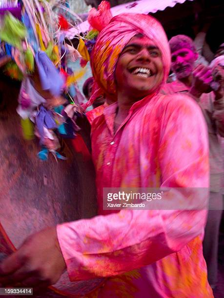 The streets fill with people running shouting giggling and splashing on March 5 2007 in a village of Brij Bhoomi India