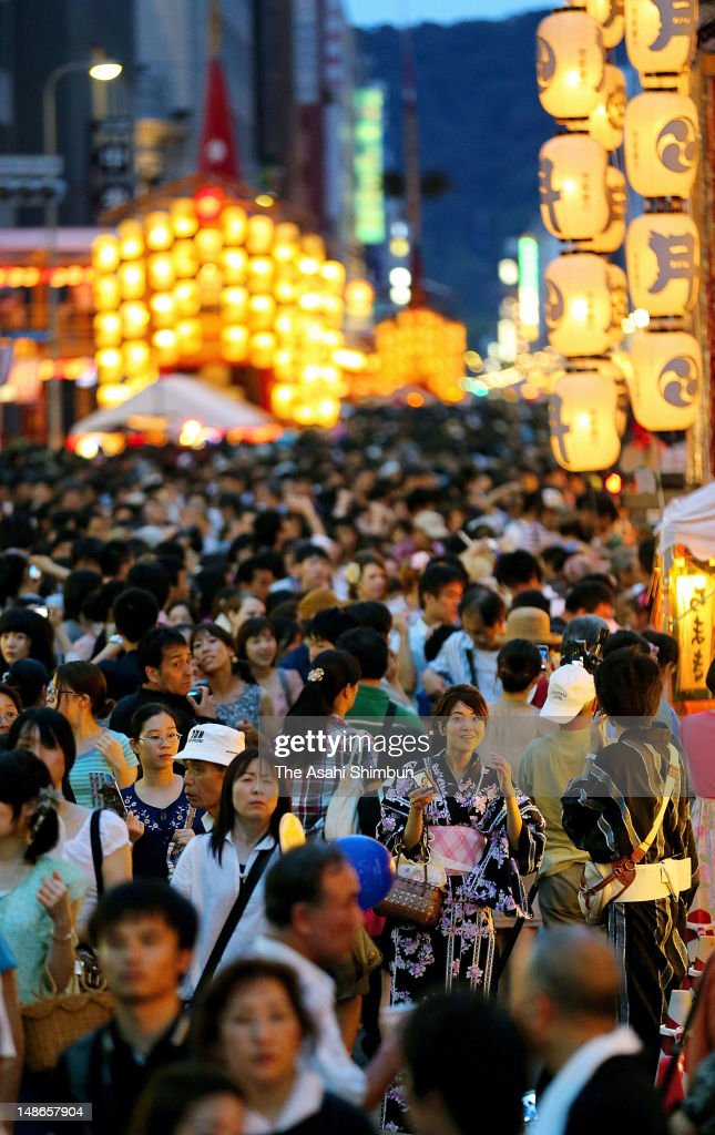 The streets of Kyoto are packed for Yoiyoiyama during the month-long Gion Festival on July 15, 2012 in Kyoto, Japan. Even the sweltering summer heat cannot keep the crowds from Kyoto's annual festival, as some 50,000 revelers packed the streets, 20,000 more than last year.