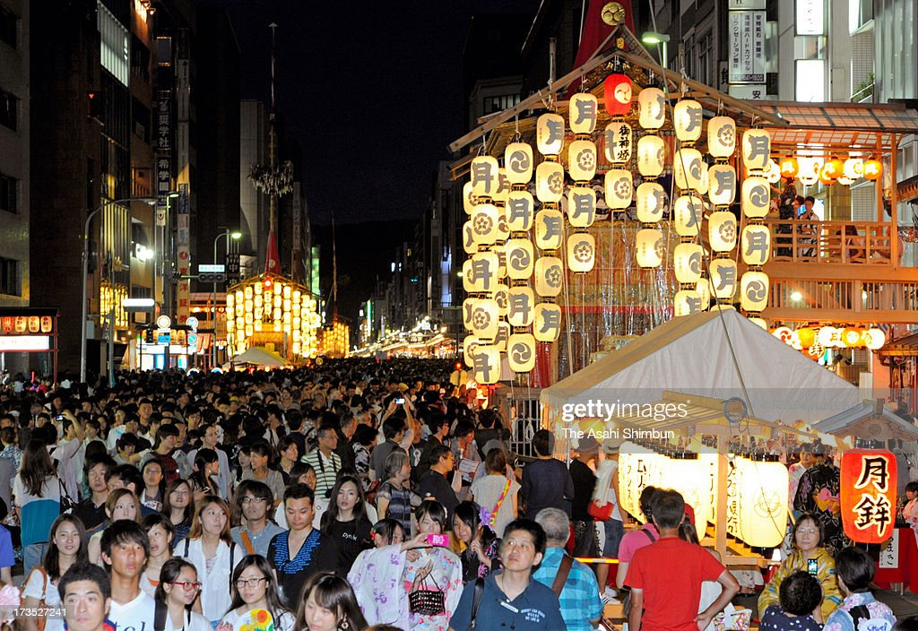 The streets of Kyoto are packed for Yoiyoiyama during the month-long Gion Festival on July 15, 2013 in Kyoto, Japan. 230,000 people enjoyed, the highlight of the festival 'Yamahoko' will take place on July 17.