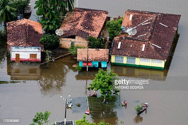 The streets of the eightthousandinhabitants town Presidente Jucelino 120Km from Sao Luis remain covered by the waters of the flooded Preto river in...