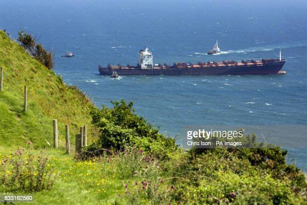 The stricken container ship MSC Napoli sits beached off the South Devon coast near Sidmouth after explosive devices blew a hole in the deck plates