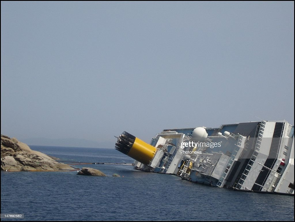 The stricken Costa Concordia lies on its side as operations to refloat the capsized cruise liner continue July 2, 2012 in Giglo Porto, Italy. The recovery operations to refloat and remove the cruise ship are organized by the U.S. firm Titan Salvage, owned by Crowley Maritime Corp, and Italian firm Micoperi and are set to cost at least $300 million and last about a year. The ship ran aground in January; killing at least 30 people with 2 still unaccounted for.