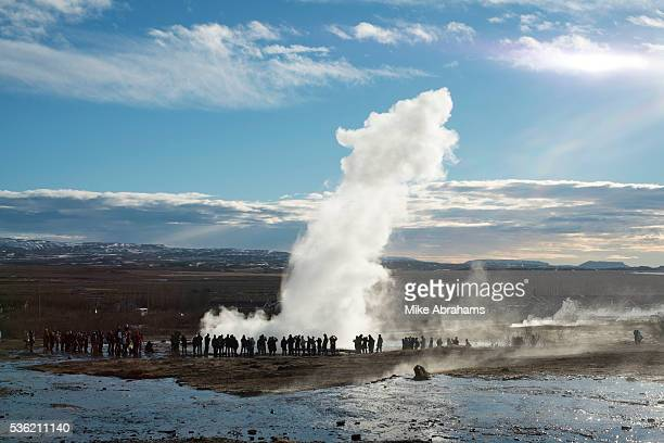 The Strokkur geyser erupting hurling boiling water some 20 metres high Strokkur is a fountain geyser in the geothermal area beside the Hvita River in...