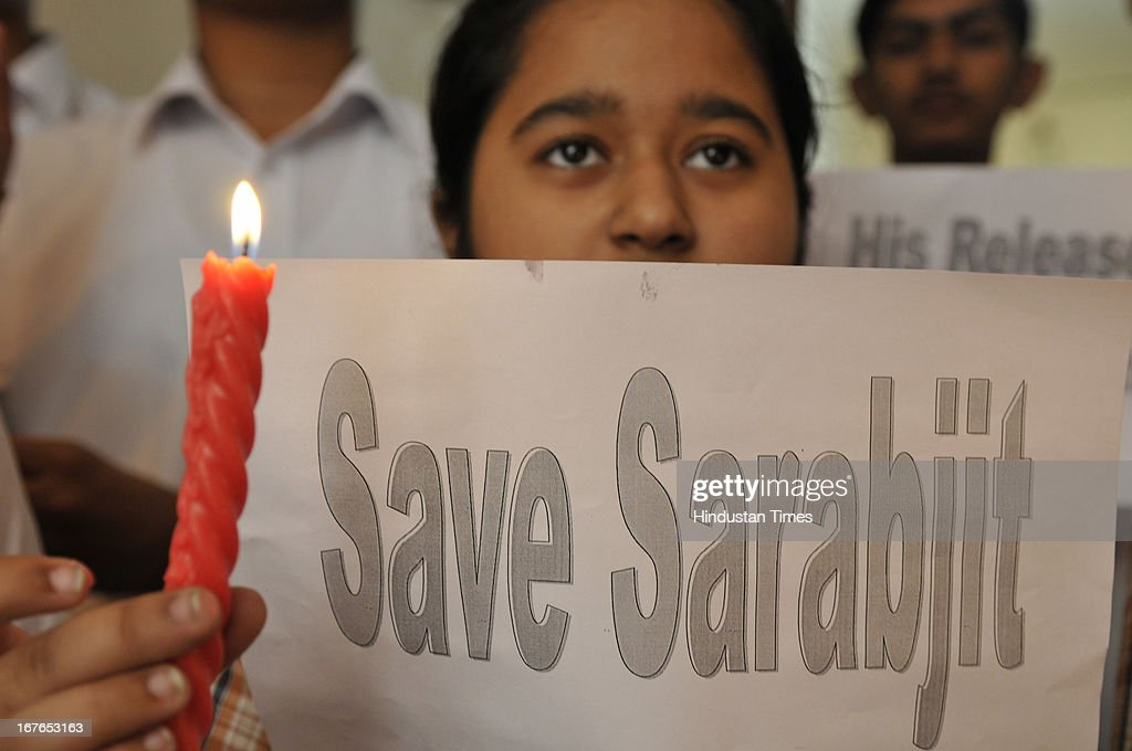 The student of DAV public School taking part in candle march while demonstrating against the deadly attack on Indian prisoner Sarabjit Singh in Pakistani Jail, on April 27, 2013 in Amritsar, India. Sarabjit's family going to apply Pakistani Visa to meet Sarabjit in Pakistani hospital. According to the source, Sarabjit was hit on the head with bricks and his neck and stomach were cut with blades. Sarabjit was admitted to the state-run Jinnah Hospital with a severe head injury on Friday evening. Sarabjit was convicted for alleged involvement in a string of bomb attacks in Punjab province that killed 14 people in 1990.