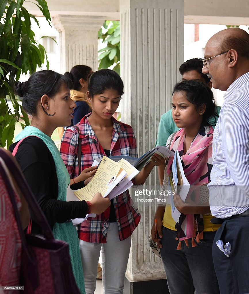 The students are busy in filling up admission forms for the new academic session 2016-17 after the first cut off list was out at Daulat Ram at North Campus on June 30, 2016 in New Delhi, India.