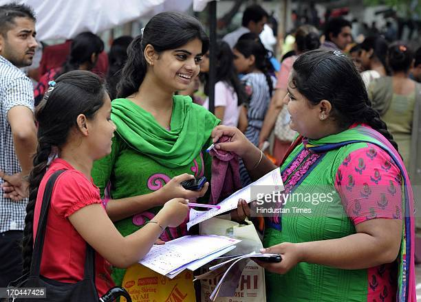 The students filing their admission forms for fouryear undergraduate programme at the Arts Faculty at North Campus on June 13 2013 in New Delhi...