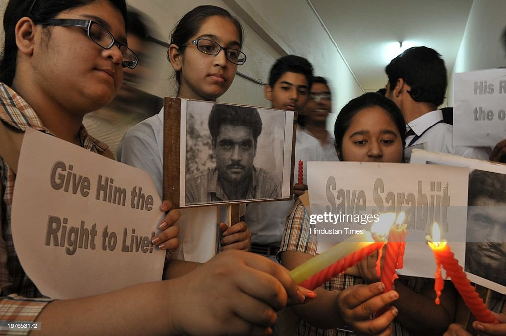 The students of DAV public School taking part in candle march while demonstrating against the deadly attack on Indian prisoner Sarabjit Singh in Pakistani Jail, on April 27, 2013 in Amritsar, India. Sarabjit's family going to apply Pakistani Visa to meet Sarabjit in Pakistani hospital. According to the source, Sarabjit was hit on the head with bricks and his neck and stomach were cut with blades. Sarabjit was admitted to the state-run Jinnah Hospital with a severe head injury on Friday evening. Sarabjit was convicted for alleged involvement in a string of bomb attacks in Punjab province that killed 14 people in 1990.