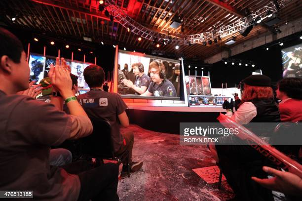 The studio audience reacts to a win by League of Legends professional team Evil Genius during the League of Legends North American Championship...
