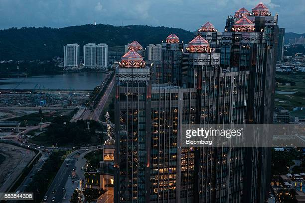 The Studio City casino resort developed by Melco Crown Entertainment Ltd is seen from the Parisian's Eiffel Tower attraction in Macau China on...
