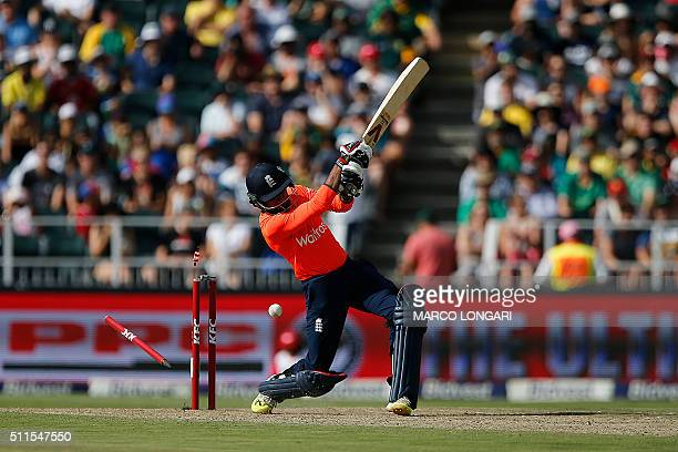 The stumps fly as England batsman Adil Rashid is bowled out by South African bowler Kagiso Rabada during the second T20 cricket match between South...