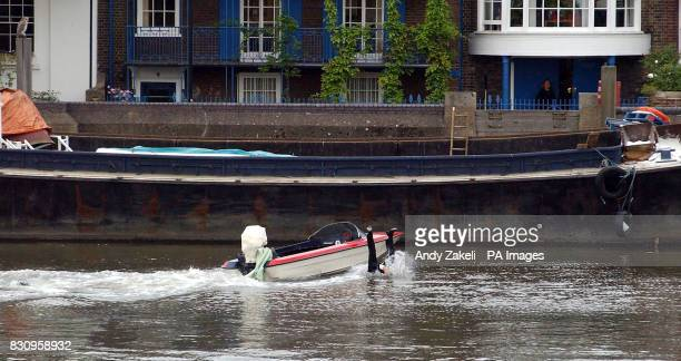 The stunt double of Luke Goss formerly of the pop group Bros leaps from the boat during the filming of 'Charlie' on the River Thames London