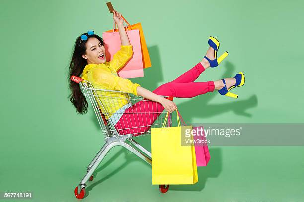 The stylish young woman is shopping