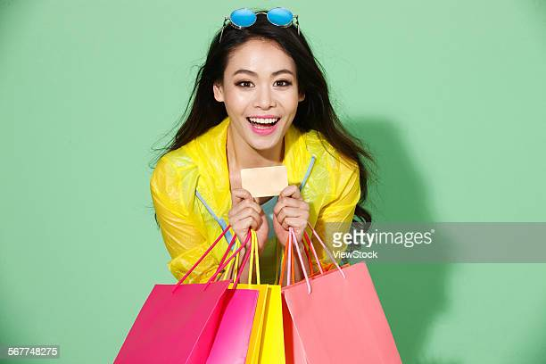 The stylish young woman shopping