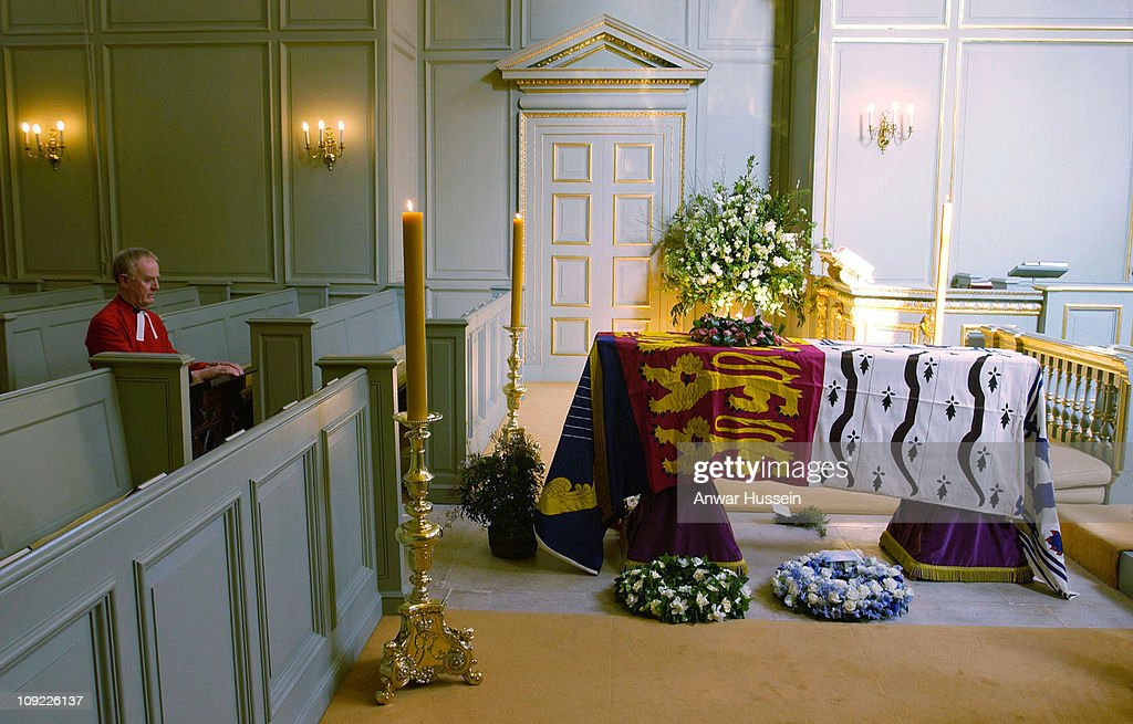 The Sub-Dean of the Chapels Royal, Reverend Willie Booth, kneels in prayer at the head of the coffin of Queen Elizabeth, The Queen Mother, in the Queen's Chapel at St James's Palace, central London on April 2002