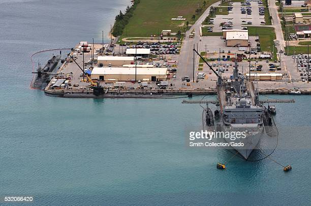 The submarine tender USS Emory S Land AS 39 provides support services to the Los Angelesclass fast attack submarines USS Topeka SSN 754 USS Tucson...