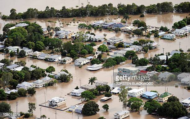 The suburb of Depot Hill is submerged after the swollen Fitzroy River broke its banks and flooded the city of Rockhampton on January 5 2011 Tens of...