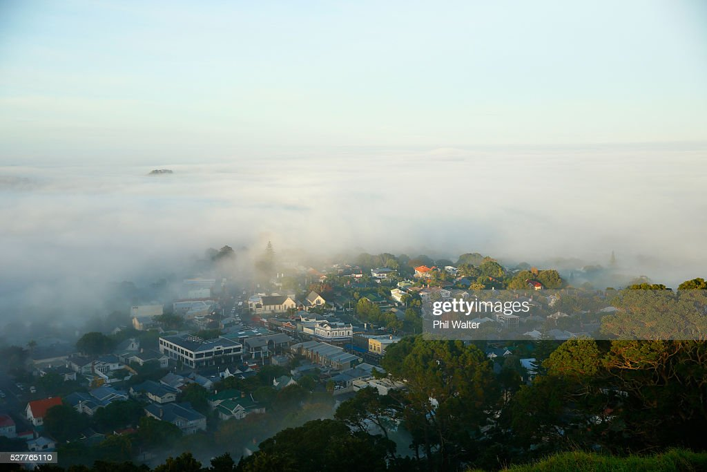 The suburb of Mt Eden struggles to break through a blanket of fog over Auckland City on May 4, 2016 in Auckland, New Zealand. The morning fog disrupted flights and ferry services in the city.