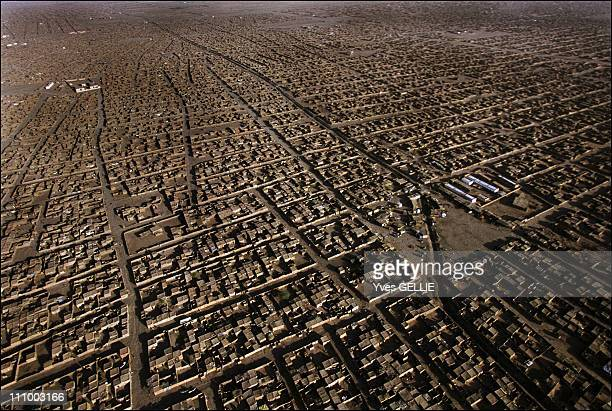 The suburbs of the largest displaced people camp in the Nile Valley in Khartoum Sudan in July 2004 Shantytowns have been proliferating for the past...