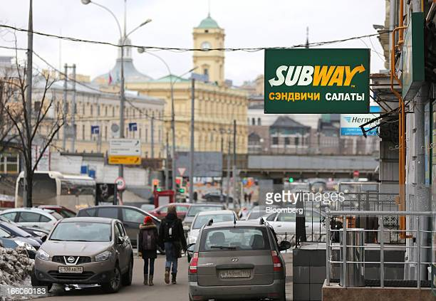 The Subway name appears in Russian on a sign outside a Subway fast food restaurant in Moscow Russia on Sunday April 7 2013 McDonald's which virtually...