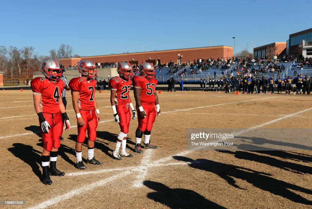 The Suitland High School football captains get ready to shake hands with their opponents from Wise before the Maryland 4A South region football final on Saturday, November 17, 2012. Wise defeated Suitland 41-6.