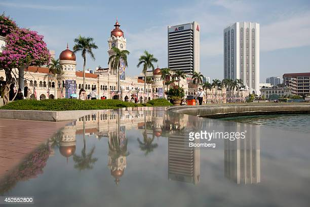 The Sultan Abdul Samad Building is reflected on a marble surface at Merdeka Square in Kuala Lumpur Malaysia on Sunday July 20 2014 Malaysian Airline...