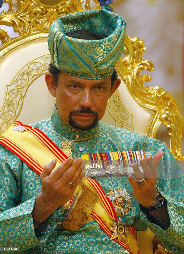 BEGAWAN, BRUNEI - SEPTEMBER 5. The Sultan of Brunei attends the powdering ceromony of his son at The Sultans Palace Diraja September 5, 2004 in Bandar Seri Begawan, Brunei. His Royal Highness Prince Haji Al-Muhtadee Billah ibni Sultan Haji Hassanal Bolkiah Mu?izzaddin Waddaulah, the Crown Prince of Brunei Darussalam and his bride Princess Dayangku Sarah binti Pengiran Salleh Ab Rahaman were taking part in the traditional ceremony of Majlis Istiadat Berbedak Pengantin Diraja.. The Royal couple is anointed with herbs and pastes as part of the many traditional events leading up to the culmination of wedding ceremony on Wednesday.