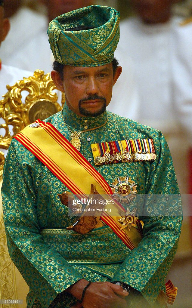 BEGAWAN, BRUNEI - SEPTEMBER 5. The Sultan of Brunei attends the powdering ceromony of his son at The Sultans Palace Diraja September 5, 2004 in Bandar Seri Begawan, Brunei. His Royal Highness Prince Haji Al-Muhtadee Billah ibni Sultan Haji Hassanal Bolkiah Mu?izzaddin Waddaulah, the Crown Prince of Brunei Darussalam and his bride Princess Dayangku Sarah binti Pengiran Salleh Ab Rahaman were taking part in the traditional ceremony of Majlis Istiadat Berbedak Pengantin Diraja. The Royal couple is anointed with herbs and pastes as part of the many traditional events leading up to the culmination of wedding ceremony on Wednesday.