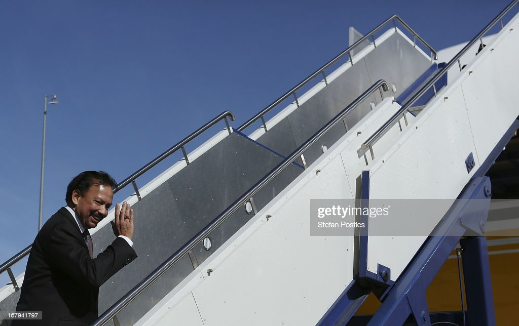 The Sultan of Brunei, Hassanal Bolkiah waves as he boards his plane at Fairbairn Defence Establishment on May 3, 2013 in Canberra, Australia. The Sultan met with Prime Minister Julia Gillard and Governor General Quentin Bryce during his three day visit to Australia for talks to strengthen the bilateral relationship between the two nations.
