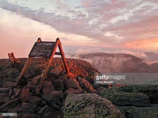 The summit sign on Maines Mount Katahdin seen at sunrise.