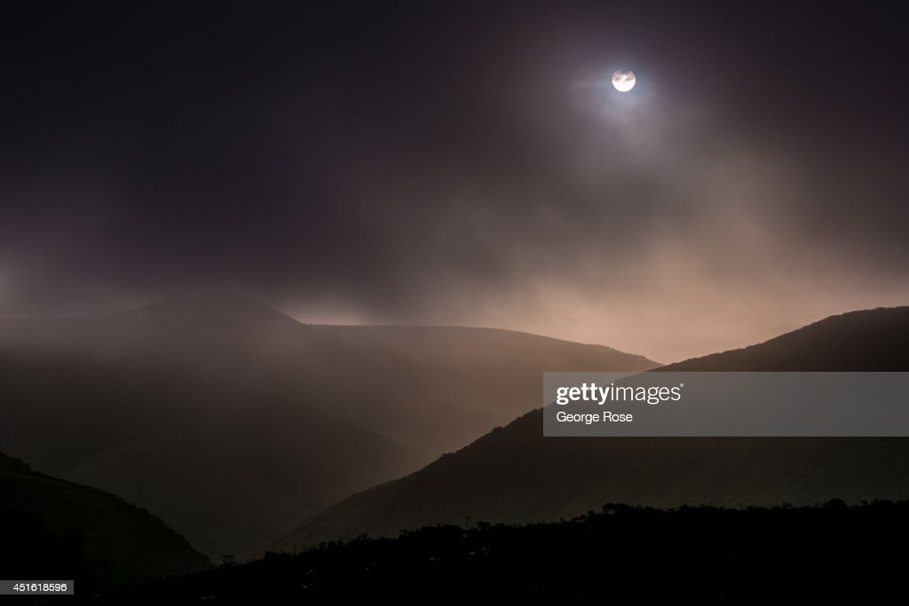 The sun attempts to break through the fog in the hillsides near Sonoma County's Doran Regional Park beach on April 23, 2014, in Bodega Bay, California. Warm sunny skies in Sonoma County Wine Country have turned springtime into summer beach weather conditions.