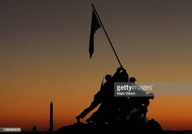 The sun begins to rise behind the Iwo Jima Memorial on November 10 2010 in Arlington Virginia Established by the Continental Congress on November 10...