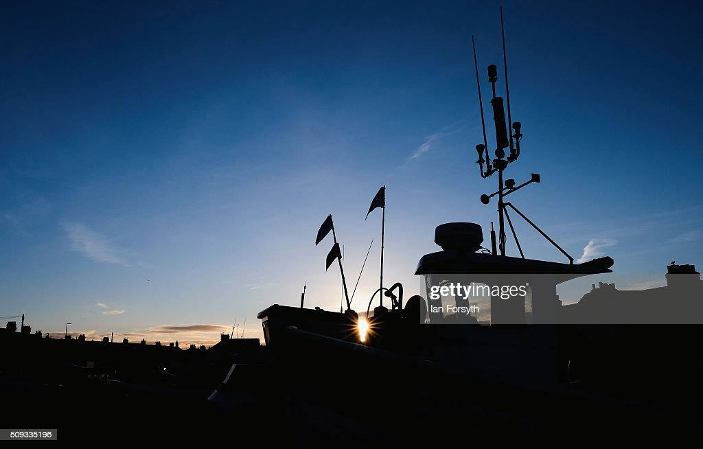 The sun begins to rise over fishing boats in an area known as Fisherman's Square on February 10, 2016 in Redcar, England. The inshore fishing fleet at Redcar originated in the early 14th Century with crab, lobster and fishing bringing in much needed income to local fishermen. As the fishing industry has steadily declined so to the fleet has reduced in size so that today only a small number of boats still put to sea from the town to continue the fishing heritage on the east coast of England.