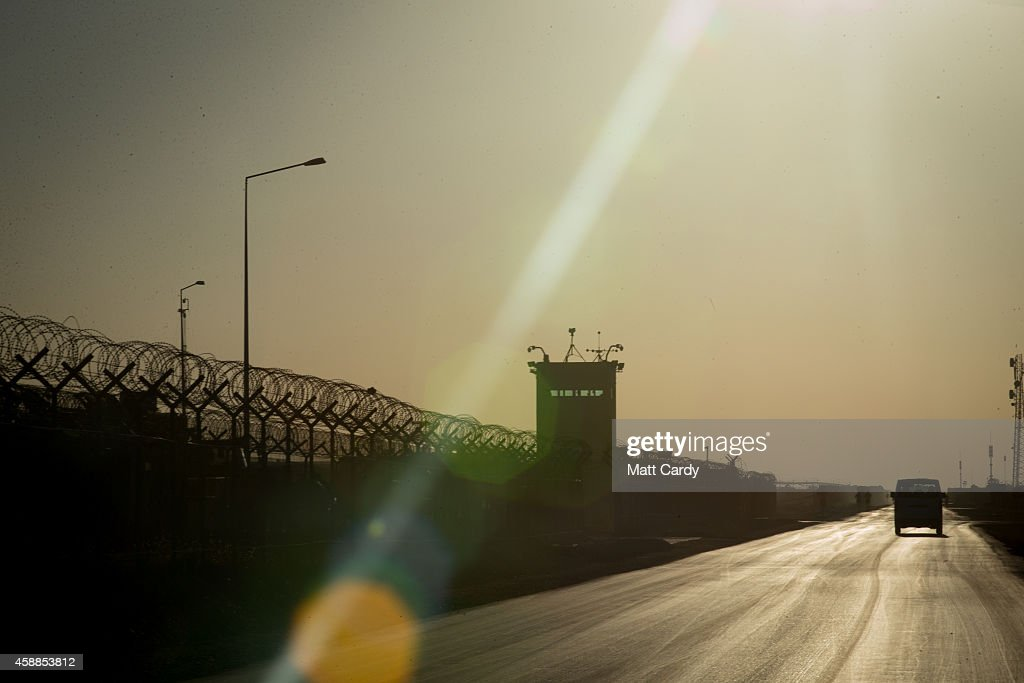 The sun begins to set at Kandahar airfield on November 12 2014 in Kandahar Afghanistan Now that British combat operations have ended and the last UK...
