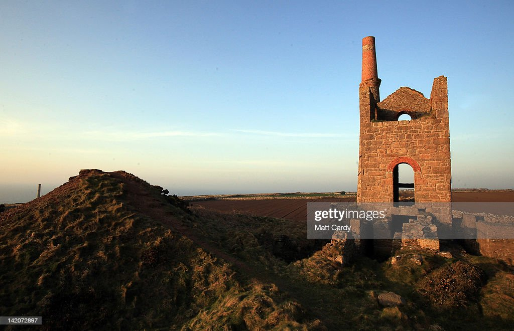 The sun begins to set over the National Trust's Botallack tin mine near St Just on March 29, 2012 in Cornwall, England. With only a few months to go until the opening ceremony of the London 2012 Olympic games, Britain's tourist industry is hoping to benefit from the influx of athletes, officials and visitors.