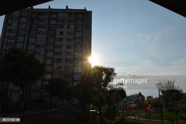 The sun can be seen shinning behind a residence during a hot summer day in Ankara Turkey on August 22 2017