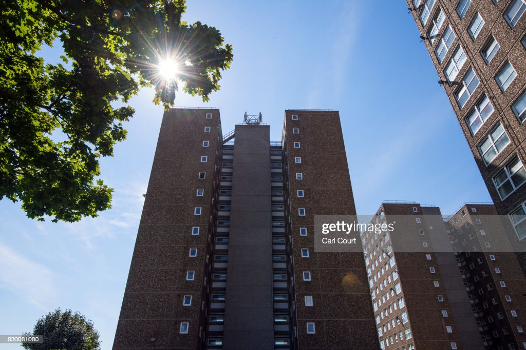 The sun glints through the leaves of a tree on the Ledbury Estate on August 11, 2017 in London, England. Hundreds of residents of the estate are to be evacuated from four tower blocks over safety fears after a survey, ordered after the Grenfell Tower fire, found cracks in the walls leaving it vulnerable to collapse in the event of a gas explosion.