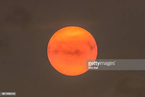 The sun goes a golden yellow colour due to dust from the Sahara being blown in with Storm Ophelia on October 16 2017 in Fulham London UK