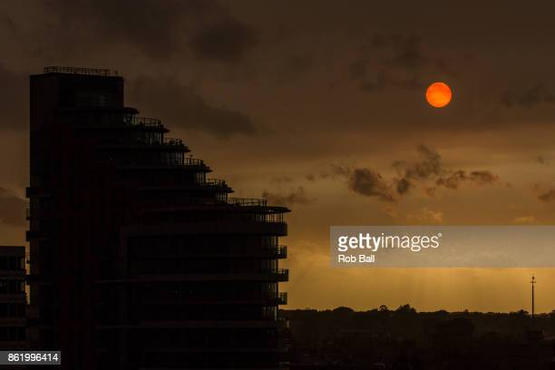 The sun goes a golden yellow colour over Putney due to dust from the Sahara being blown in with Storm Ophelia on October 16 2017 in Putney London UK