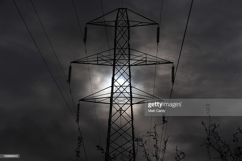 The sun goes behind an electricity pylon that is sited besides the M5 motorway near Winscombe on November 6, 2012 in Somerset, England. The National Grid released today its draft Hinkley C to Avonmouth connection route which would involve replacing existing pylons with fewer but larger ones and will also use underground cables in the Mendip Area of Outstanding National Beauty. However campaigners how have been fighting against the new power line, have claimed the proposals will still have a detrimental effect on the landscape.