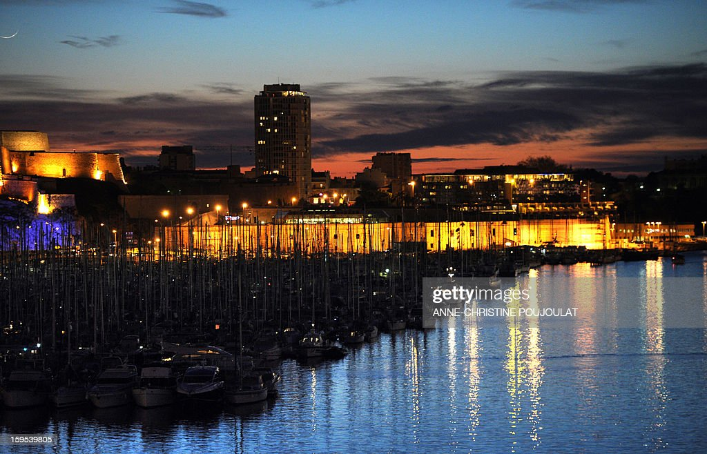 The sun goes down at the Vieux-Port harbour in Marseille, southern France on January 12, 2013.