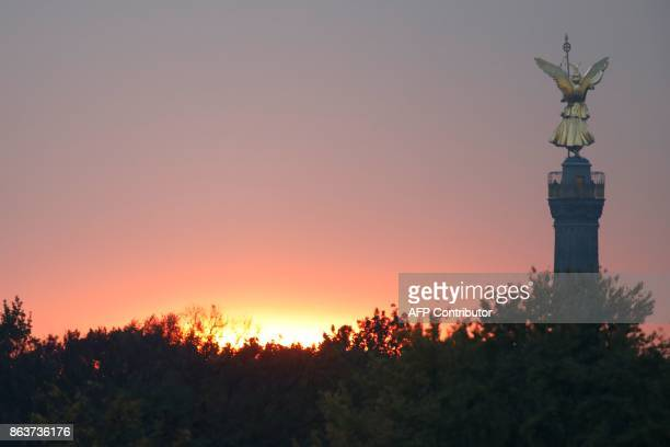 The sun has set behind the landmark Victory Column in Berlin as the delegations of the CDU/CSU conservative alliance the liberal FDP party and the...