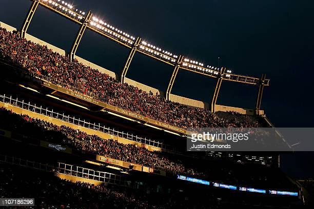The sun illuminates a portion of the east stands in the third quarter of an NFL game between the St Louis Rams and Denver Broncos at INVESCO Field at...