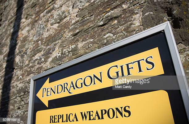 The sun illuminates a sign for a shop in Tintagel on April 27 2016 in Cornwall England The English Heritage managed site and the nearby town have...